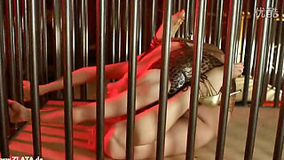 Sexy blond in a cage