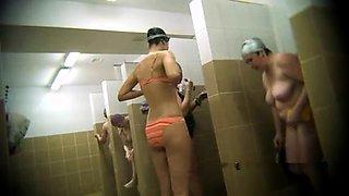 Kinky voyeur spying on amateur Asian ladies taking a shower