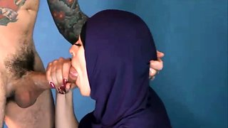 Islamic woman in hijab gives blowjob