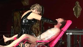 Awesome blonde dominatrix spanking her thrall