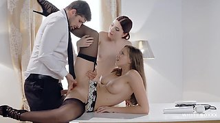 Hot brunettes in erotic lingerie and stockings are getting fucked hard on the working desk