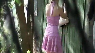 2 women peeing outdoors