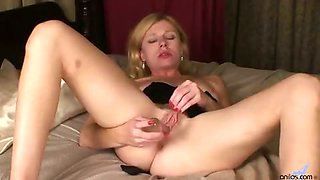 Petite milf wakes up horny and puts her glass dildo to good