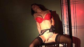 Solo Jessica Jaymes masturbates in black stockings