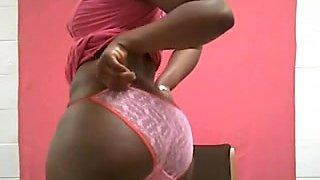Curvy Ebony chick recording an erotic dance for her customer