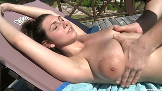 Big tits with amazing areolas getting oiled up
