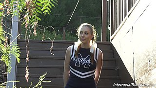 Horny cheerleader named Arietta Adams is mouthfucked by strong black studs