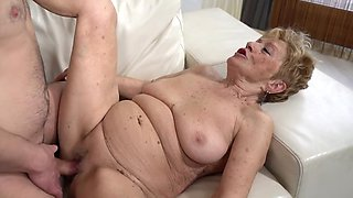 A nasty old granny is getting fucked in her pussy doggy style