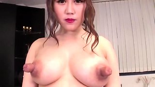 Voluptuous Oriental cutie puts her huge nipples on display