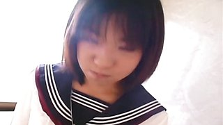 Young Japanese schoolgirl gives her first blowjob