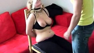Big breasted amateur blonde learns a lesson in bondage
