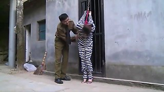 Chinese Prison Girl in Metal Bondage