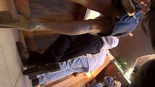 Slender amateur teen in high heels upskirt in a public place
