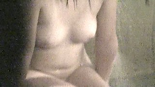 Wet bodied Asian shows her natural tits on shower spy cam nri003 00