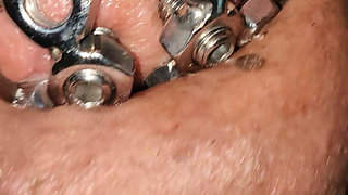 close up of the set screw in my chastity cage