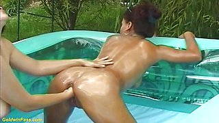Hot Mom Gets Oil Fisted by Stepdaughter