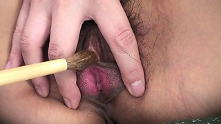 Brushing her clit with a brush after a finger fuck