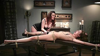 Girl is whipped and scored in bottom by lesbian roommate
