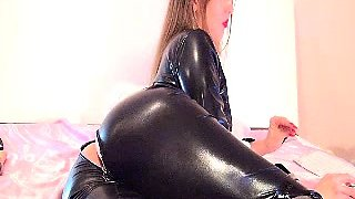 Sensuous camgirl in black latex fucks her cunt with a dildo