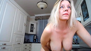Sexy Mature in kitchen