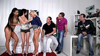 Three girls are doing some sexy things with some guys in this video