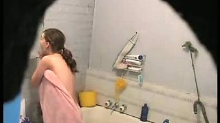brunette girl gets nude and takes a quick bath in a shower porno