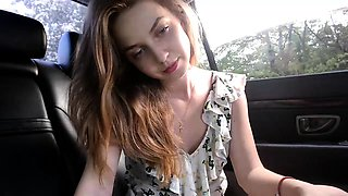 Enticing camgirl puts her lovely tits on display in the car